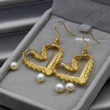 The latest fashion design openwork lace heart-shaped earrings women's simple fashion charm earrings