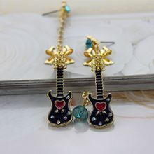 Free shipping exquisite deserve to act the role of a long a short fashion accessories alloy gold bowknot guitar stud earrings