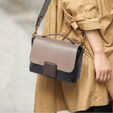 New wave womem's European and American fashion first layer leather hand strap shoulder slung casual hit color leather handbag